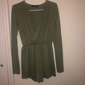 Olive green romper. Long sleeve. Shorts